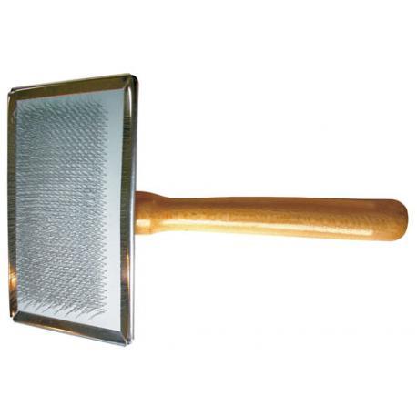 Étrille métallique avec poils recourbés